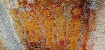 Ancient cave art depicting Aliens and a UFO in India.