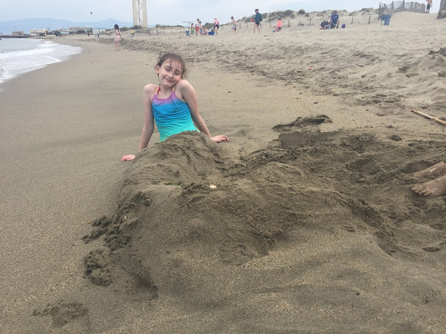 Sasha as a mermaid in sand