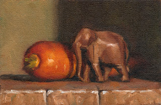 Oil painting of a carrot next to a small wooden elephant.