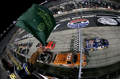 Tyler Reddick, driver of the #29 Cooper Standard Ford, leads the field  at the start of the NASCAR Camping World Truck Series UNOH 200