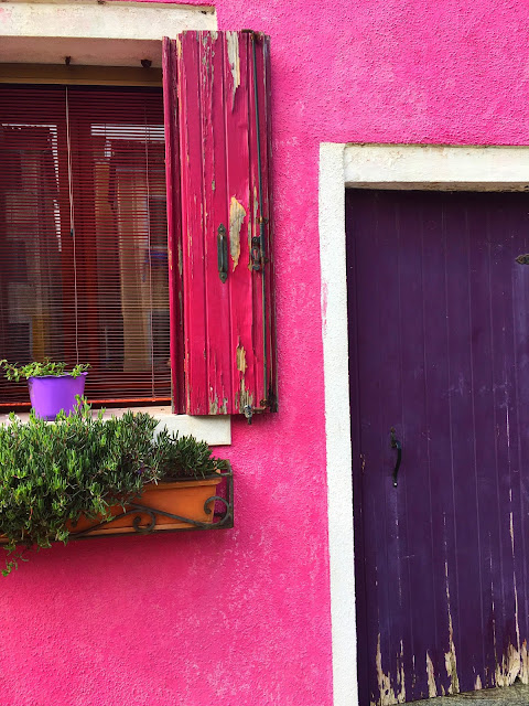 pink house in burano, italy