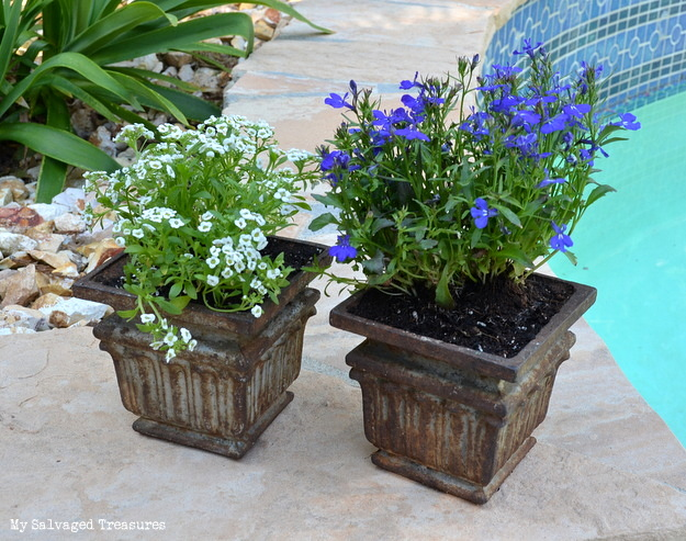 use old cast iron post bases as flower pots