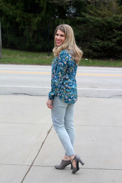 teal floral top, grey jeans, grey suede booties, blush Cole Haan bag