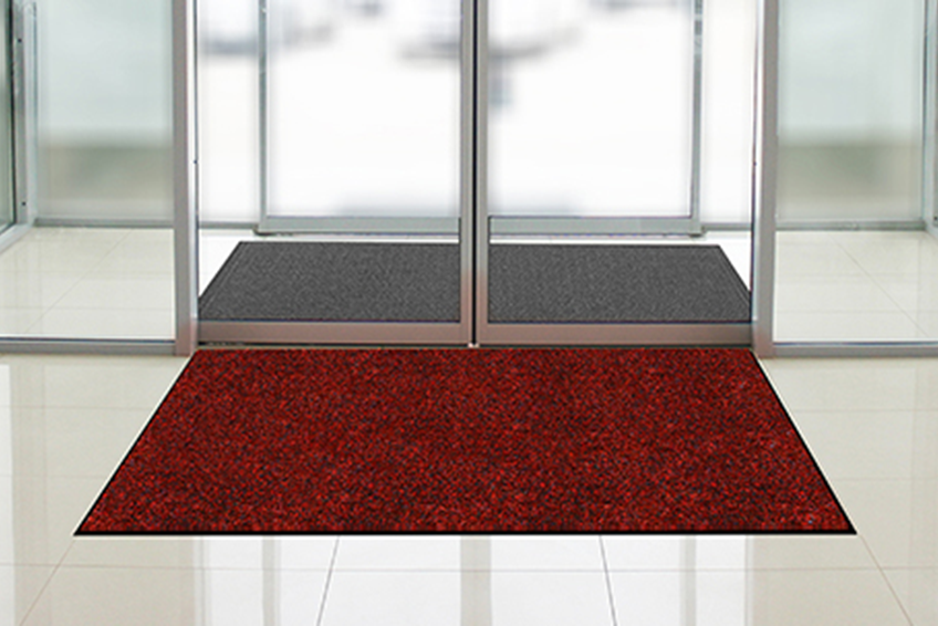 red entryway mat at glass doors