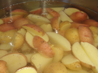 quartered potatoes boiling