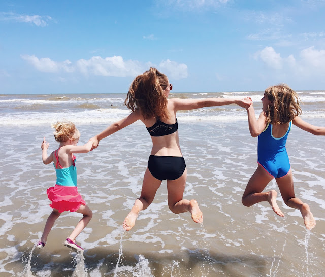 Galveston Travel Guide sisters on beach vacation