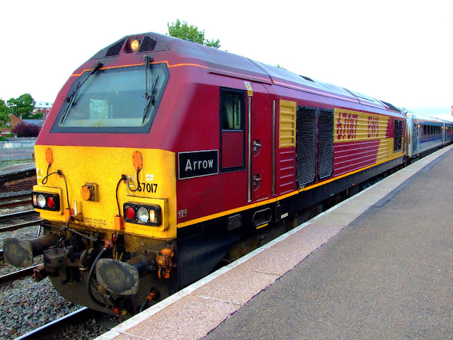 Photo of EWS Locomotive 'Arrow' standing in Leamington Spa railway station whilst hauling a Chiltern Railways passenger train.  These Class 67 locomotives were eventually replaced by the newer Class 68.