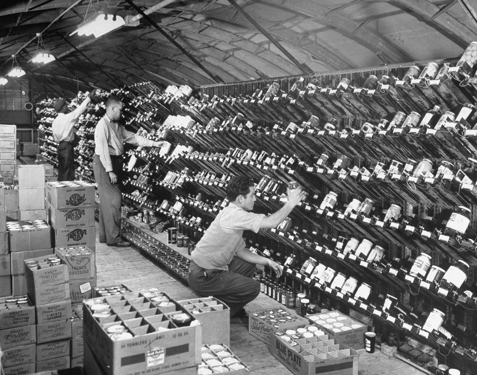 A worker stocks the grocery chutes in the Keedoozle.