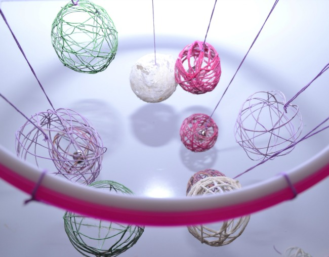 A photo of the Easter eggs hanging from the embroidery hoop.