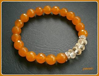 bransoletka pomarańczowa na gumce, kwarc, cyrkonie