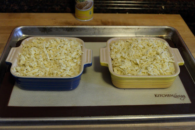 The truffled mac-and-cheese, in the baking dished, on a baking sheet.