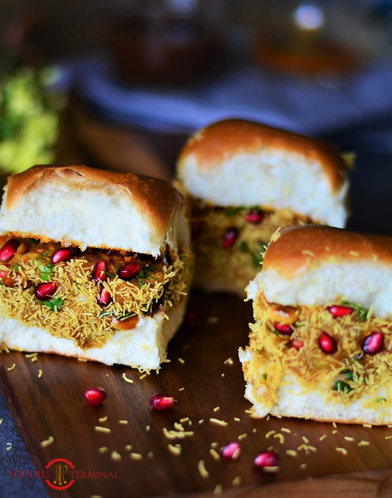 Kutchi Dabeli recipe, garnished with sev and stuffed with the potato filling.