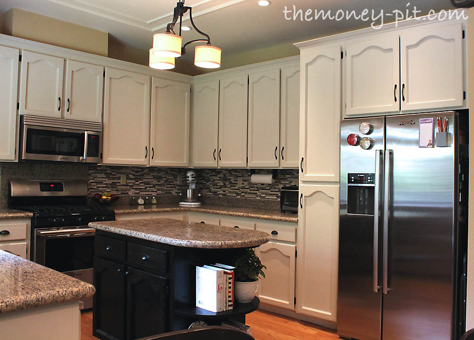trash can kitchen cabinet small with dining table you believe that is the same kitchen?!?!?!