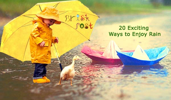 Enjoy rain like a kid in yellow raincoat and rubber boots with umbrella near paper boats