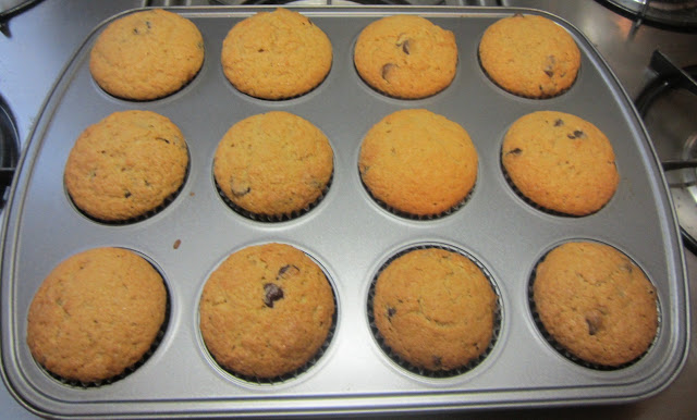 Food Lust People Love: These sour cream chocolate chip muffins are sweet but not too sweet, with fluffy insides perfectly complemented by the semi-sweet chocolate chips. Bake a batch for someone you love!