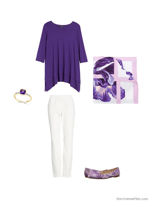 wearing an ultraviolet tunic with white denim pants