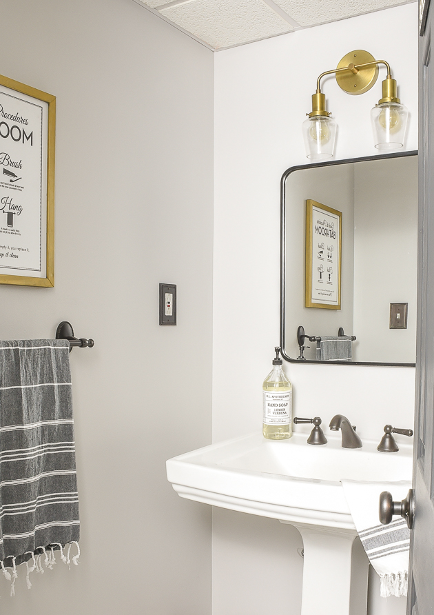 vintage modern bathroom makeover with brass accents