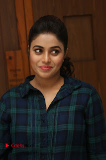 Actress Poorna Stills in Denim Jeans at Jayammu Nischayammu Raa Movie Interview 0027