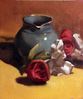 Oil painting of a large blue jug beside red plastic roses and white plastic lillies.