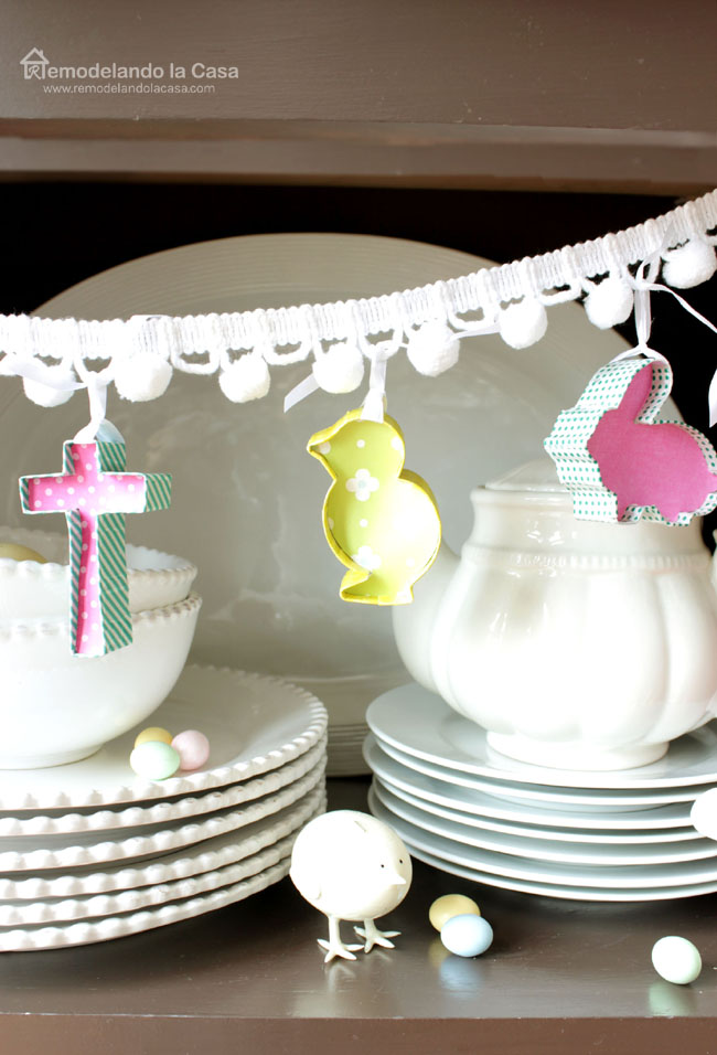 a cute easter bunting on pom-poms adorning a cupboard