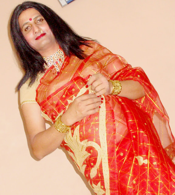boy wearing red saree