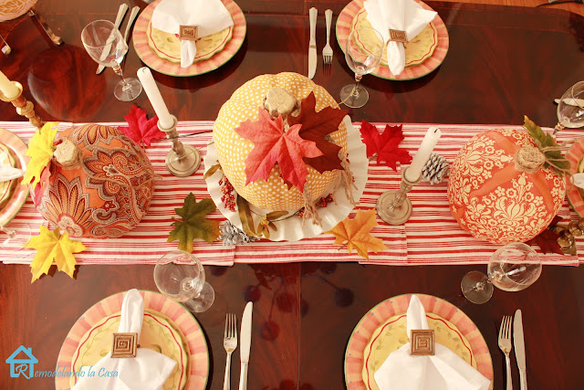 Mahogany table with runner centerpiece - fall leaves, yellow and orange dishes