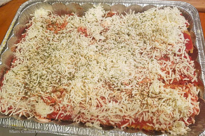 how to make homemade lasagna from scratch with homemade sauce, cheese, herbs and this is ready for the oven