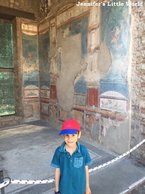 Child in front of villa in Pompeii