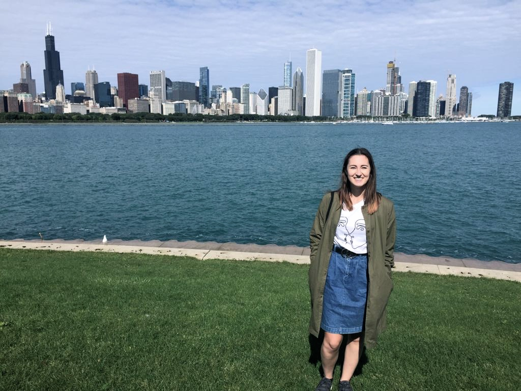 Me, standing in front of the city skyline and Lake Michigan