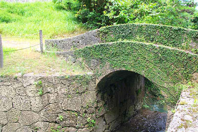 A small, stone, arched bridge