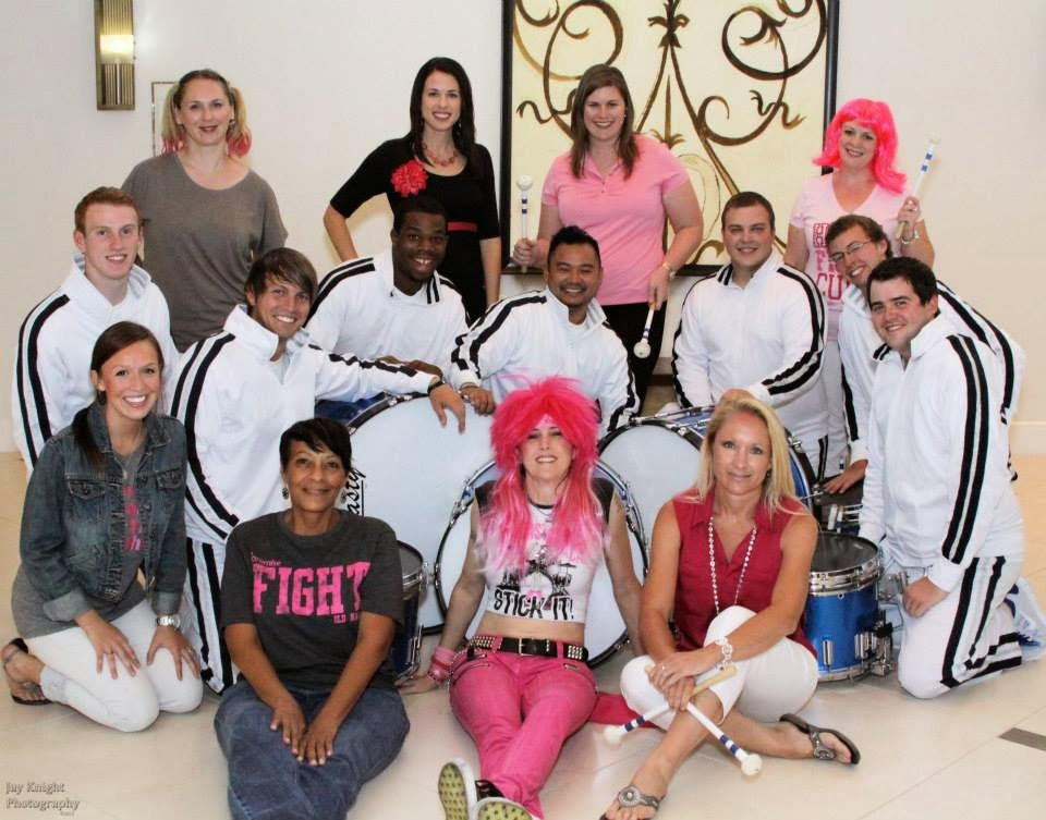 The Dallas Cowboys Rhythm & Blue Drumline with Komen staff including Race For The Cure Co-Chairs