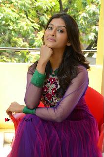 Actress Pooja Jhaveri Latest Stills in Purple Salwar Kameezt at Dwaraka Success Meet  0226.JPG