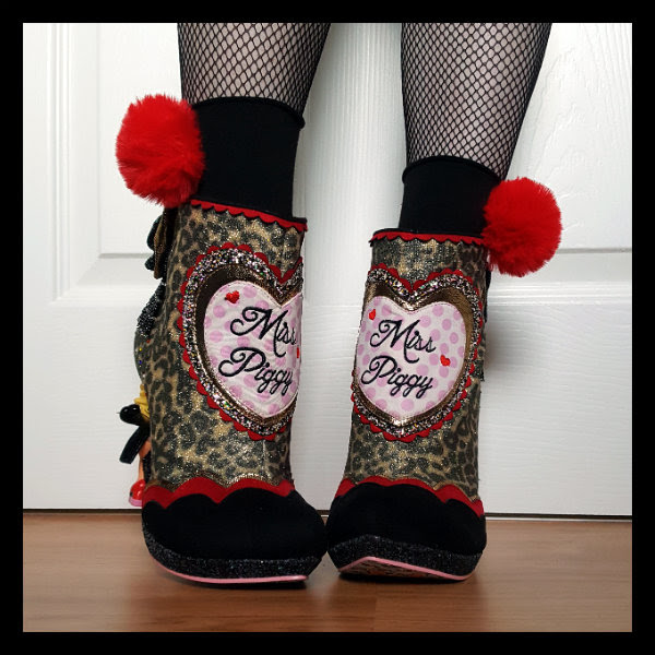 front view wearing leopard print Muppets boots with heart applique