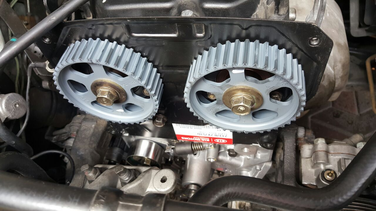hight resolution of timing belt replacement photo shows genuine waterpump is being install