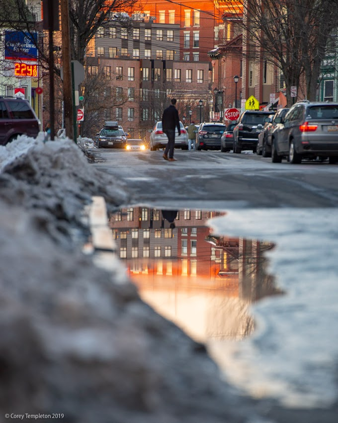 Portland, Maine USA March 2019 photo by Corey Templeton. While it's not officially spring yet, puddle season has arrived in the streets of Portland.