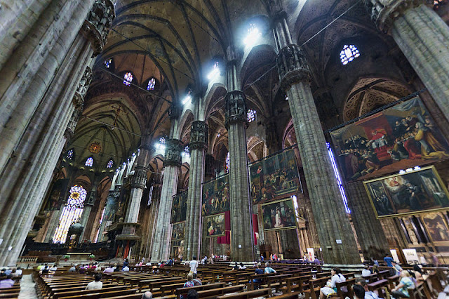 A soaring nave that stretches to Heaven, magnificent artwork and sarcophagi await inside the world's 5th-largest cathedral in Milan. Photo: Jean-Christophe Benoist.
