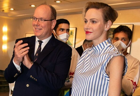 Princess Charlene wore Louis Vuitton sleeveless top with button detail. Princess Gabriella. sleeveless blouse by Louis Vuitton