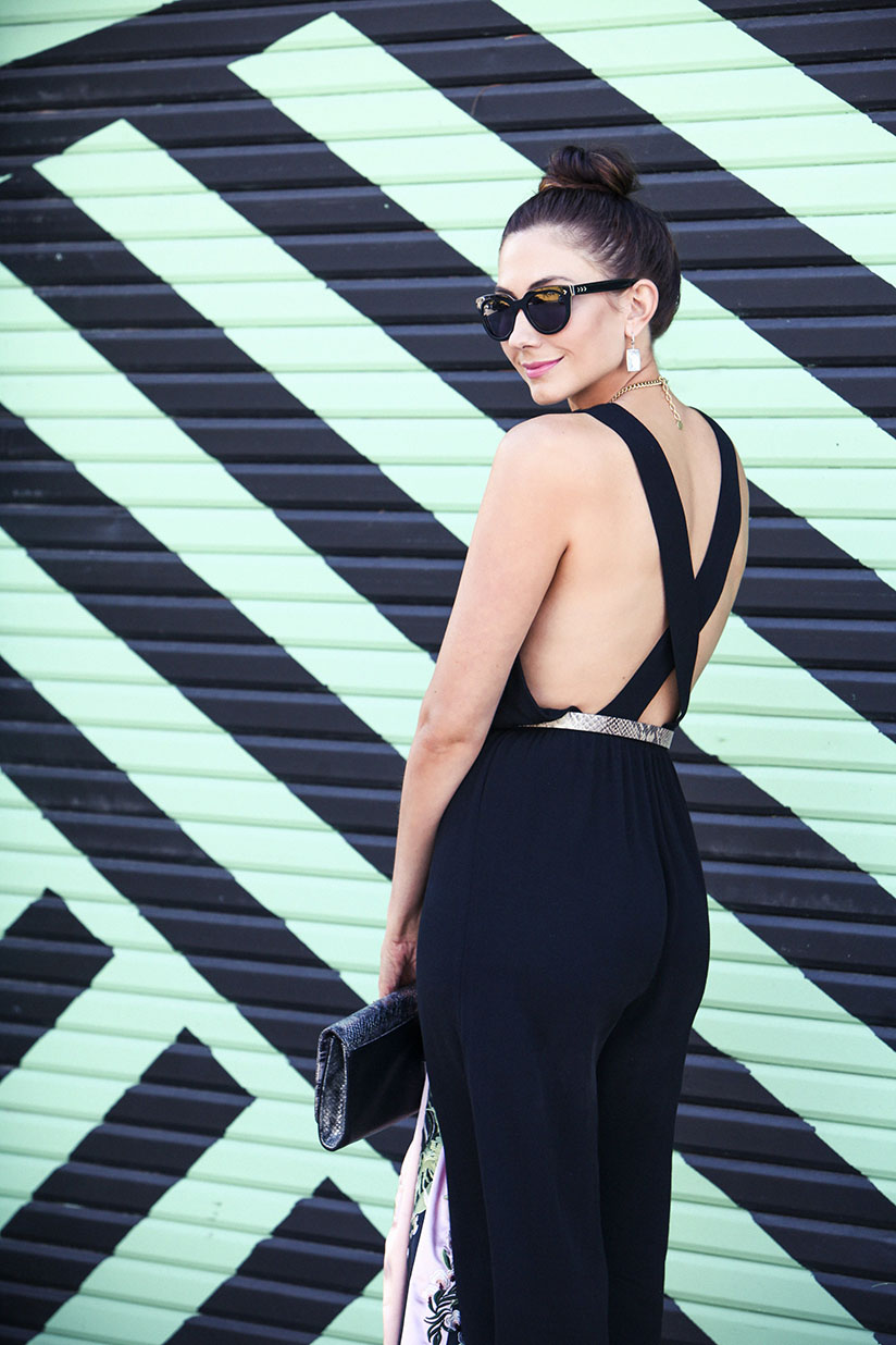 Amy in strappy back black jumpsuit by Tobi