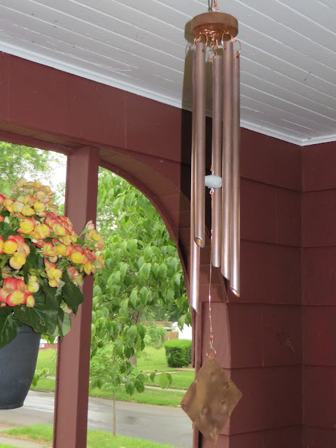 Copper wind chime hanging at a customer's home