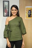 Pragya Jaiswal in a single Sleeves Off Shoulder Green Top Black Leggings promoting JJN Movie at Radio City 10.08.2017 077.JPG