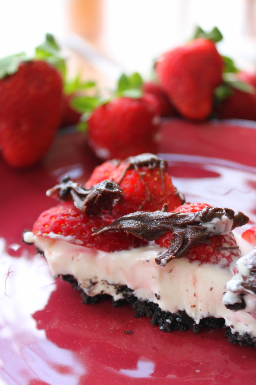 If you are looking for easy dessert recipes, you will love this strawberry cake recipe. It is a refrigerator cake that uses a boxed cake mix as the base and has strawberry puree pour over top. The frosting is a Cool Whip and Instant Vanilla Pudding mixture and is then topped with fresh strawberries and pecans.