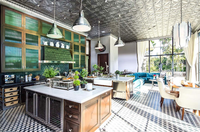 Gourmet kitchen cement tile floor, large silver pendant lights, breakfast nook pressed tin ceiling