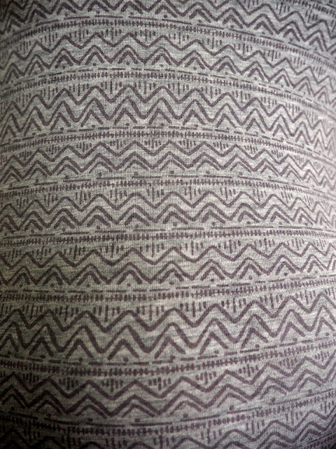Hiking | outfit close up of geometric purple design on light grey top