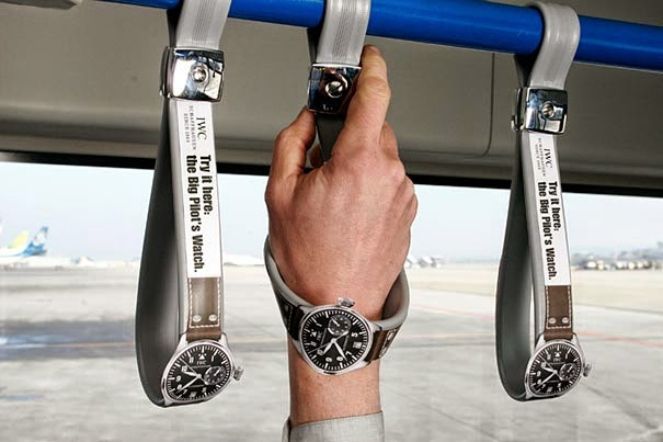 Hand positioned within the hand rail straps, modified to resemble watches.