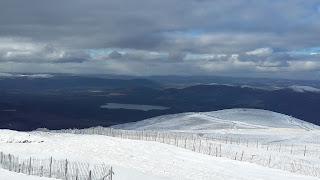 View from the top of the mountain, showing a little snow