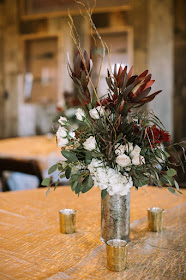 Wedding centerpieces in mercury glass containers