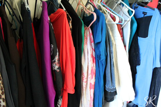 a closet full of clothes