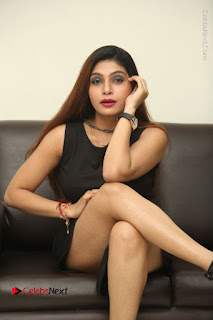 Tollywood Upcoming Actress Pooja Roshan Stills in Black Short Dress at Plus 1 Movie Trailer Launch  0265.JPG
