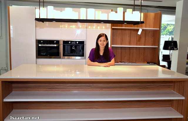 Here's Janice again with one of the huge kitchen cabinets on display