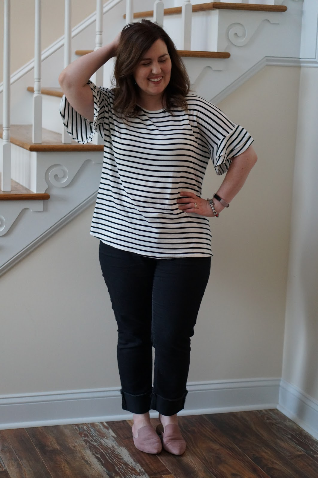 Popular North Carolina style blogger shares how to style a ruffle sleeve tee for work.  Click here to read it!